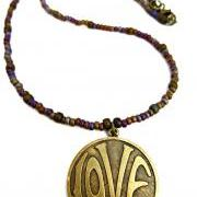 LOVE necklace. Purple & gold. Brass metal love circle pendant with glass seed beads. Beaded necklace. Boho. Hippie. simple.