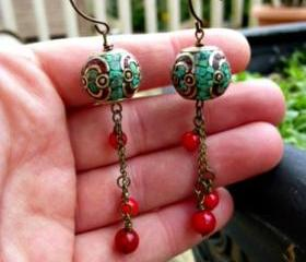 Red coral beads, turquoise inlaid bead. Dangle earrings