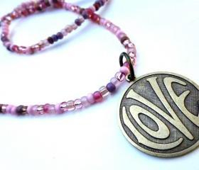 LOVE necklace. Brass metal love circle pendant with pink matte and shiny glass seed beads. Beaded necklace. Boho. Hippie. simple.