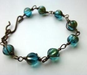 Teal, aqua, brown pumpkin Czech Picasso glass wire wrapped bracelet. Jewelry, Glass, Teal, Aqua, brown.